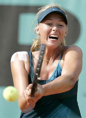 Sharapova yells as she hits the ball, shoulder injury has healed
