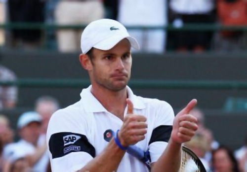 Adny Roddick thumbs up after beating Lleyton Hewitt at the 2009 Wimbledon